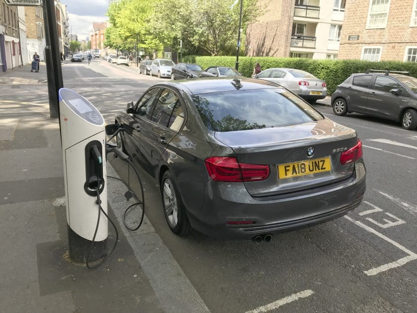 BMW being charged at roadside